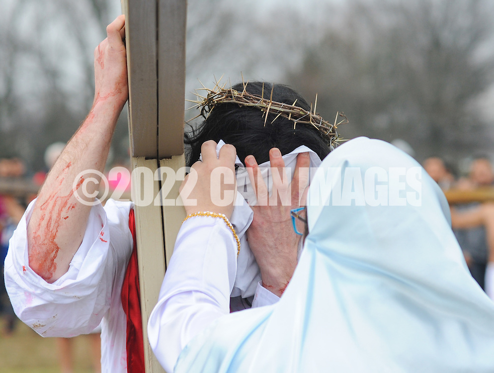 Roberto Marquez, of Bensalem, Pennsylvania portrays Jesus as he Veronica wipes his face during the Stations of the Cross leading to his crucifixion on Good Friday April 3, 2015 at Our Lady of Fatima in Bensalem, Pennsylvania.  (Photo by William Thomas Cain/Cain Images)