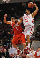 March 1, 2009- Boston University junior guard Corey Lowe (13) grabs a rebound, while University of Hartford senior guard Jaret von Rosenberg (1) tries to block him during a game at Agganis Arena in Boston, MA. BU won, 67-57, in overtime.