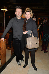 EDWARD HALL and his wife ISSY VAN RANDWYCK at a reception and debate to celebrate the publication of  'Women in Waiting, Prejudice at the the Heart of the Church' by Julia Ogilvy held at St.James's Church, 197 Piccadilly, London on 11th March 2014.