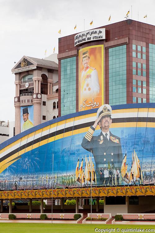 Propaganda images of Hassanal Bolkiah, the Sultan of Brunei, atop the Parade ground or Taman Haji Sir Muda Omar Ali Saifuddien and surrounding buildings, Bandar Seri Begawan, Brunei