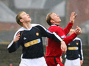Looking up - Dundee's Kevin McDonald and Clyde's Jorg Albertz during the IRN BRU Scottish League First Division match at Dens Park