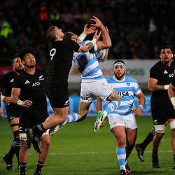 Emiliano Boffelli takes a high ball under pressure from TJ Perenara during the Rugby Championship match between the NZ All Blacks and Argentina Pumas at Yarrow Stadium in New Plymouth, New Zealand on Saturday, 9 September 2017. Photo: Dave Lintott / lintottphoto.co.nz