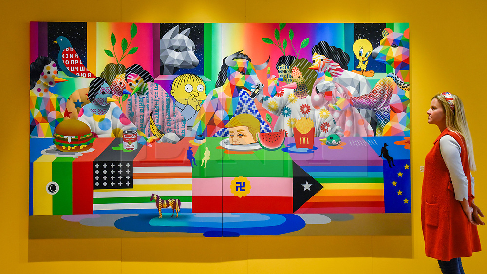 "© Licensed to London News Pictures. 04/10/2019. LONDON, UK. A visitors views ""Last Supper II"", 2019, by Okuda San Miguel at Moniker International Art Fair, an urban contemporary art fair taking celebrating its 10 year anniversary in the UK.  The fair is  place at Chelsea's Sorting Office air until 6 October 2019.  Photo credit: Stephen Chung/LNP"