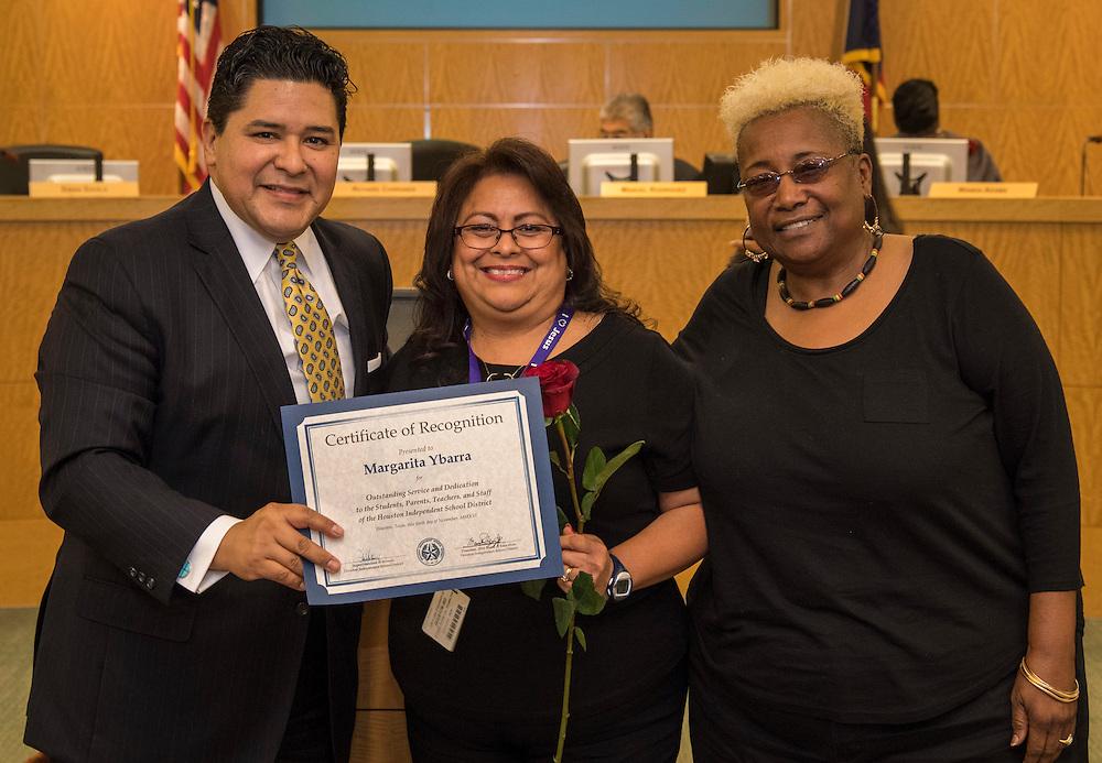 Superintendent Richard Carranza, left, and Wretha Thomas, right, recognize Margarita Ybarra, center, during the Houston ISD Board of Trustee meeting, November 10, 2016.