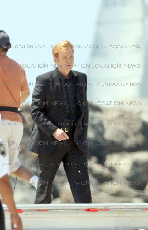 LONG BEACH, CALIFORNIA - Wednesday July 25th 2007. EXCLUSIVE: Actor David Caruso plays Lieutenant Horatio Caine on the set of the hit Tv show CSI: Miami. Photograph: David Buchan/Onlocation news. Sales: Eric Ford 1/818-613-3955 info@onlocationnews.com.<br /> City: <br /> [click to edit]