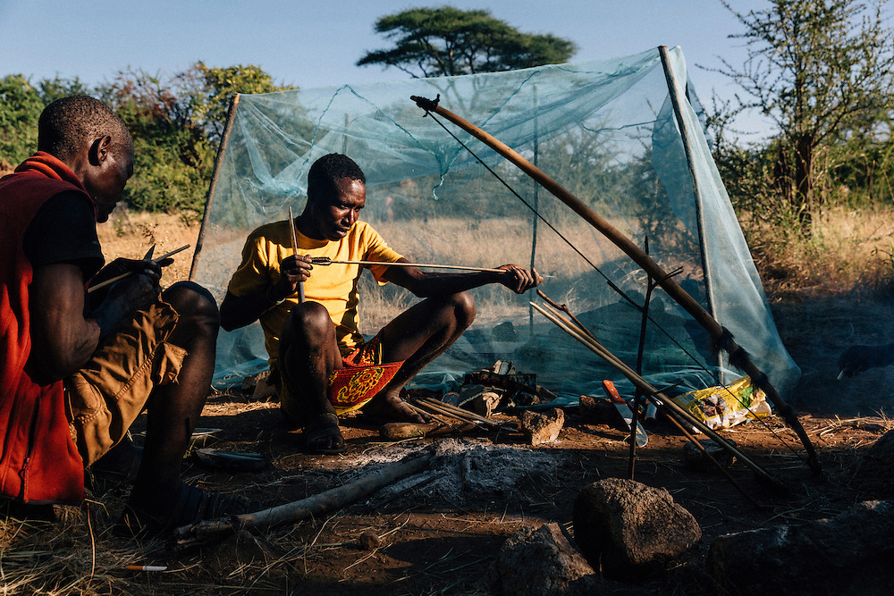 Male members of the Hadza tribe spend a morning mending and making arrows. Yaeda valley area in Northern Tanzania. Photo by Greg Funnell, March 2016.