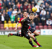 28th April 2018, Fir Park, Motherwell, Scotland; Scottish Premier League football, Motherwell versus Dundee; Cammy Kerr of Dundee battles for the ball with Richard Tait of Motherwell