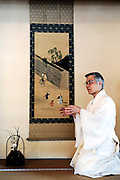 Shigeho Yoshida, chief priest at Tsurugaoka Hachimangu shrine, explains the history of the Yabusame Shinji, a Japanese ritual, in Kamakura, near Tokyo on 17 Sept. 2008. The ritual, which involves several riders on horseback firing arrows at targets while galloping at speed, dates back to the 12th century and is aimed at appeasing the numerous gods that guard Japan. It was initiated by Kamakura shogun Minamoto no Yoritomo  in an attempt to improve his samurai warrior's appalling archery skills..Photographer: Robert Gilhooly