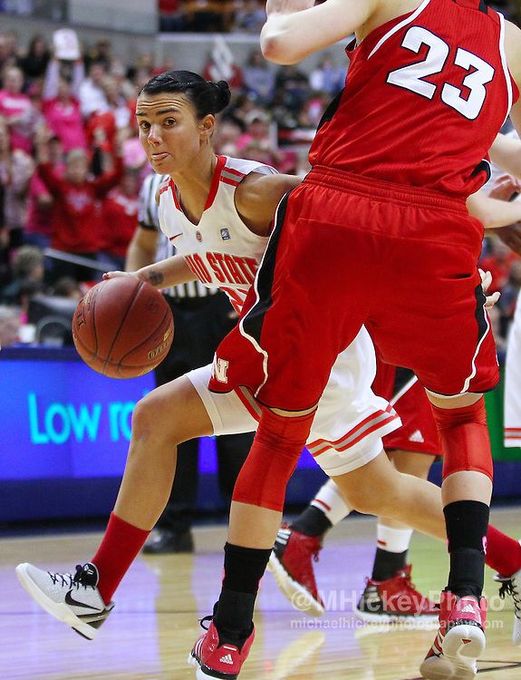 March 03, 2012; Indianapolis, IN, USA; Ohio State Buckeyes guard Samantha Prahalis (21) drives the ball around Nebraska Cornhuskers forward Emily Cady (23) during the semifinals of the 2012 Big Ten Tournament at Bankers Life Fieldhouse. Nebraska defeated Ohio State 77-62. Mandatory credit: Michael Hickey-US PRESSWIRE