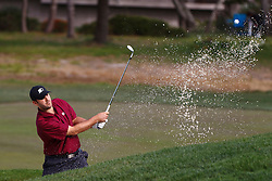 Feb 10, 2012; Pebble Beach CA, USA; Dallas Cowboys quarterback Tony Romo hits a shot out of a bunker on the third hole during the second round of the AT&T Pebble Beach Pro-Am at Monterey Peninsula Country Club. Mandatory Credit: Jason O. Watson-US PRESSWIRE