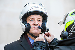 © Licensed to London News Pictures. 11/02/2018. London, UK. Alastair Campbell is strapped into a motorbike helmet after leaving BBC Broadcasting House. Photo credit: Rob Pinney/LNP