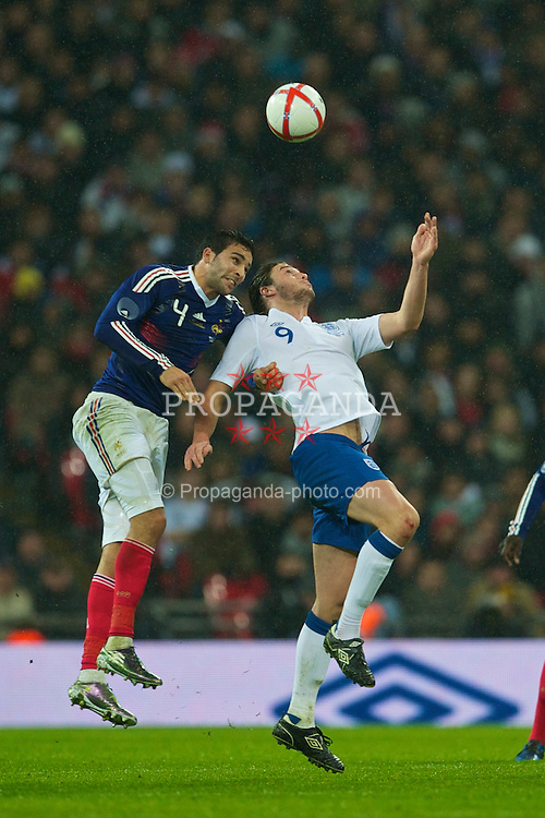 LONDON, ENGLAND - Wednesday, November 17, 2010: England's Andy Carroll in action against France's Adil Rami during the International Friendly match at Wembley Stadium. (Pic by: David Rawcliffe/Propaganda)