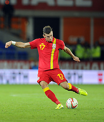 Gareth Bale of Wales (Real Madrid) see's his free kick well saved  - Photo mandatory by-line: Joe Meredith/JMP - Tel: Mobile: 07966 386802 10/09/2013 - SPORT - FOOTBALL - Cardiff City Stadium - Cardiff -  Wales V Serbia- World Cup Qualifier