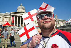 © Licensed to London News Pictures. 20/04/2019. London, UK. A man wearing England Flag design sunglasses with England flags attends the annual 'Feast of St George' event in Trafalgar Square, to celebrate the Patron Saint of England. St George's Day is on 23 April. Photo credit: Dinendra Haria/LNP