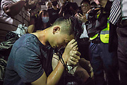 CHINA, Hong Kong: 13 August 2019 <br /> A man who is suspected of being Chinese Police has his hands tied and is surrounded by both press and angry demonstrators at Hong Kong International Airport this evening. The man, who was caught with a Chinese ID badge, was almost kicked to death by the angry mob of protesters. Demonstrators have taken to the streets of Hong Kong in protest of a controversial extradition bill since 9th of June which has resulted in several violent clashes.<br /> Rick Findler / Story Picture Agency
