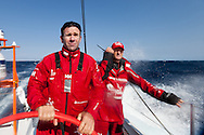 SPAIN, Alicante. 20th October 2011. On board Team Sanya practice session. Skipper Mike Sanderson (left), and Watch Leader Cameron Dunn.