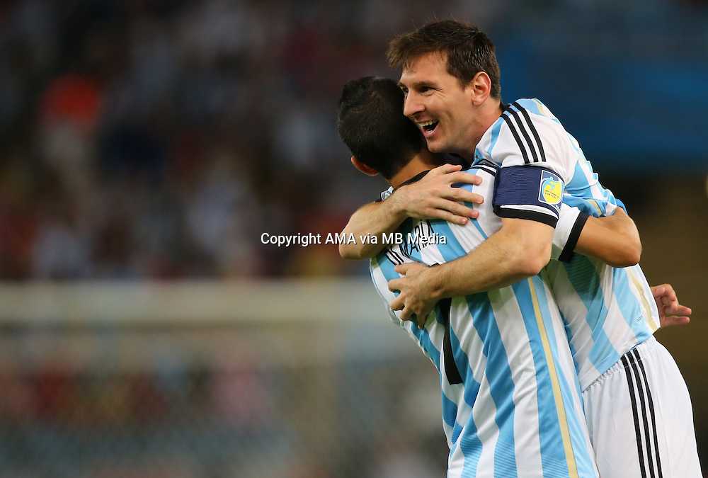 Lionel Messi of Argentina celebrates after the first goal with Angel Di Maria of Argentina