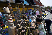 Wooden totems at a highway station.