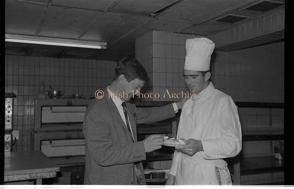 Paddy Roberts Visits the Gresham Hotel..1963..01.10.1963..10.01.1963..1st October 1963..League of ireland footballer Paddy Roberts paid a visit to the Gresham Hotel today. paddy plies his trade with Shelbourne Football Club in Dublin...Image shows Paddy Roberts sampling the wares at the Gresham.