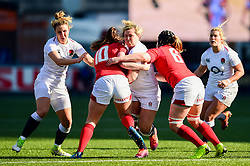 Marlie Packer of England Women is tackled by Robyn Wilkins of Wales Women and Bethan Lewis of Wales Women - Mandatory by-line: Ryan Hiscott/JMP - 24/02/2019 - RUGBY - Cardiff Arms Park - Cardiff, Wales - Wales Women v England Women - Women's Six Nations
