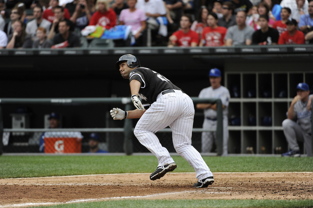CHICAGO - JULY 10:  Carlos Quentin #20 of the Chicago White Sox hits his second home run of the game in the fifth inning against the Kansas City Royals on July 10, 2010 at U.S. Cellular Field in Chicago, Illinois.  The White Sox defeated the Royals 5-1.  (Photo by Ron Vesely)