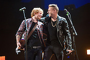 Ed Sheeran and Macklemore performing at the iHeartRadio Music Festival in Las Vegas, Nevada on Sepembter 20, 2014.
