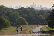 UNITED KINGDOM, London: 12 May 2020 <br /> Members of public jog through Richmond Park early this morning. The weather in the capital, although starting sunny and cold today, is set to be cloudy for the rest of the week.