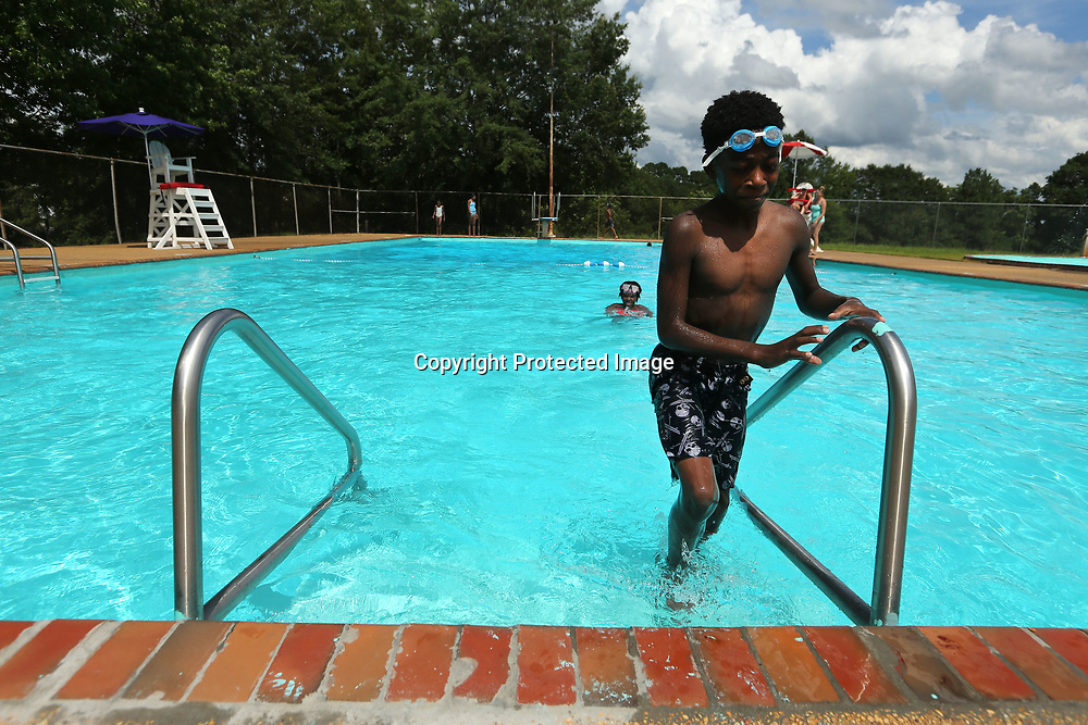 Evan Jenkins, 12, of Memphis, sets out of the C.C Augustus Pool in Tupelo on Wednesday afternoon. Jenkins spent the afternoon swimming with family during his visit to Tupelo.