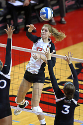13 October 2011: Emily Schneider strikes the ball in the direction of Samantha Kersting during an NCAA volleyball match between the Indiana State Sycamores and the Illinois State Redbirds at Redbird Arena in Normal Illinois.
