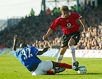 Fotball<br /> Premier League England 2004/2005<br /> Foto: BPI/Digitalsport<br /> NORWAY ONLY<br /> <br /> 30.10.2004<br /> Portsmouth v Manchester United<br /> <br /> Gabriel Heinze is tackled by Portsmouths Lomana Lua Lua