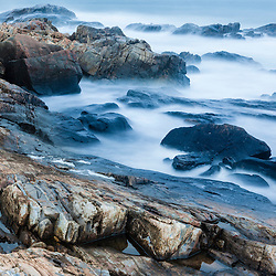 Misty surf on the rocks in Rye, New Hampshire.