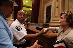 August 9, 2017 - Minneapolis, Minnesota, U.S. - Acting police chief MEDARIA ARRADONDO shook hands with Mayor BETSY HODGES as local activist CLYDE BELLECOURt patted him on the shoulder following the public hearing.The Minneapolis City Council's Public Safety, Civil Rights and Emergency Management Committee held a public hearing on the nomination of Arradondo to be the City's next police chief Wednesday, at City Hall. (Credit Image: © Anthony Souffle/TNS via ZUMA Wire)