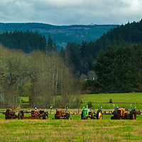 A large tractor collection surrounds a farm along Interstate 5 in southern Oregon.