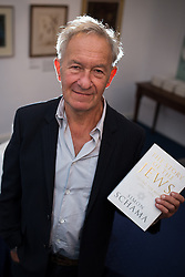 """© Licensed to London News Pictures . 11/09/2013 . Manchester Jewish Museum , Manchester , UK . Historian SIMON SCHAMA with his book """" The Story of the Jews """" at the book's official launch , at the Synagogue within the Manchester Jewish Museum , this evening (11th September 2013) . The book is released on 12th September 2013 . It is the first volume of a series , subtitled """" Finding the Words (1000 BCE - 1492 )"""" and accompanies the television series """"The Story of the Jews"""" , currently airing on BBC2 . Photo credit : Joel Goodman/LNP"""