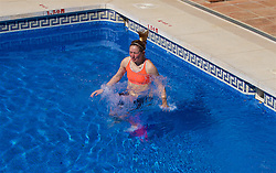 ALHAURÍN EL GRANDE, SPAIN - Tuesday, February 26, 2019: Wales' Cori Williams jumps into the water of the hotel swimming pool during a training session at the at Alhaurin Golf Resort in Spain. (Pic by David Rawcliffe/Propaganda)