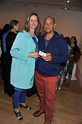 Lead singer of the band Fine Young Cannibals ROLAND GIFT and his wife LOUISE MELDRUM at a private view of work by the late Rory McEwen - The Colours of Reality, held at the Shirley Sherwood Gallery, Kew Gardens, London on 20th May 2013.