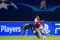 Domogoj Antolic #8 of GNK Dinamo Zagreb and Alex Oxlade-Chamberlain #15 of Arsenal F.C. during football match between GNK Dinamo Zagreb, CRO and Arsenal FC, ENG in Group F of Group Stage of UEFA Champions League 2015/16, on September 16, 2015 in Stadium Maksimir, Zagreb, Croatia. Photo by Urban Urbanc / Sportida