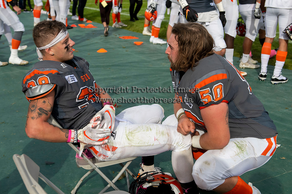 KELOWNA, BC - OCTOBER 6: Kelton Kouri #38 ices a muscle during a converation with Liam Hamlyn #50 of Okanagan Sun at the Apple Bowl on October 6, 2019 in Kelowna, Canada. (Photo by Marissa Baecker/Shoot the Breeze)