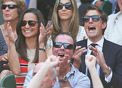 Pippa Middleton and Nico Jackson react during  Novak Djokovic's semi-final win over Juan Martin Del Potro  at the Wimbledon Tennis Championships in London, Friday, 5th July 2013<br /> Picture by Stephen Lock / i-Images