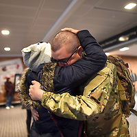 Luis Espinal, 21, embraces his mother, Janet Corona, 42, after returning from Army basic training in Fort Sill, at the Lehigh International Airport in Allentown, PA, Pennsylvania, U.S. December 20, 2016.  REUTERS/Mark Makela