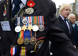 © Licensed to London News Pictures. 02/05/2012. London, UK London Mayor, Boris Johnson (right) is joined by comedian Al Murray to wave off an army of WWII veterans who are embarking on an iconic trip to the Netherlands, via a convoy of black cabs. The London Taxi Benevolent Association for the War Disabled has organised a trip for 160 WWII veterans to travel to Holland in 80 London Black Cabs. The veterans, mostly aged between 85 and 94, will start their journey from London today 2nd May 2012 and will be visiting sites of importance from WWII and taking part in Dutch Liberation Day celebrations as guests of honour of the Dutch Royal Family.. Photo credit : Stephen Simpson/LNP