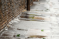 Torrential  rain causes water to force its way through a wall on Church Street Ecclesfield, Sheffield...6 July 2012.Image © Paul David Drabble