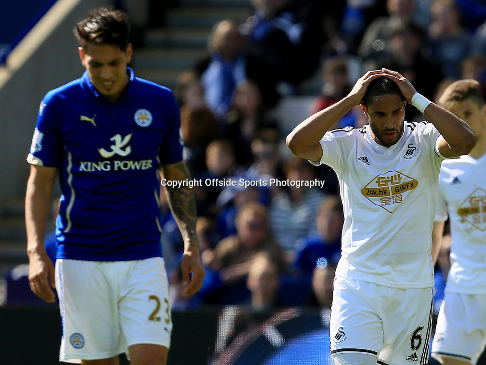 18th April 2015 - Barclays Premier League - Leicester City v Swansea - Ashley Williams of Swansea City holds his head in his hands after going a goal down to Leicester City - Photo: Paul Roberts / Offside.