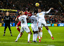 Leroy Fer of Swansea City clears from Emre Can of Liverpool - Rogan/JMP - 22/01/2018 - FOOTBALL - Liberty Stadium - Swansea, Wales - Swansea City v Liverpool - Premier League.