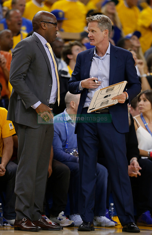 Golden State Warriors coaches Steve Kerr, right, and Mike Brown talk during a timeout against the Cleveland Cavaliers in the second quarter of Game 5 of the NBA Finals at Oracle Arena in Oakland, Calif., on Monday, June 12, 2017. (Photo by Nhat V. Meyer/Bay Area News Group/TNS) *** Please Use Credit from Credit Field ***