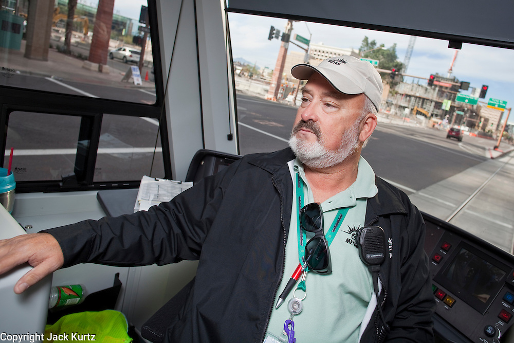 27 DECEMBER 2008 -- PHOENIX, AZ: At 9:54AM Cliff Richards (CQ) Operator #1, drove the first train out of the Phoenix station. Metro Light Rail started running Saturday, Dec. 28. The light rail line is 20 miles long and cost $1.4 billion dollars. PHOTO BY JACK KURTZ
