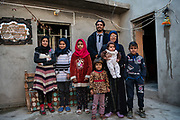4 February 2019 &ndash; Mosul &ndash; Iraq &ndash; Mother of two, Rahbia Dahesh Huseein, 50, stands for a photo with her family inside her home in West Mosul, which was damaged as a result of a nearby airstrike during the battle to liberate Mosul from ISIS control.  <br /> <br /> Rahbia&rsquo;s home is now being rehabilitated with the support of UNDP&rsquo;s Funding Facility for Stabilization (FFS), which is supporting the rehabilitation of ten thousand homes across West Mosul, helping displaced families return home. <br /> <br /> &copy; UNDP Iraq / Claire Thomas