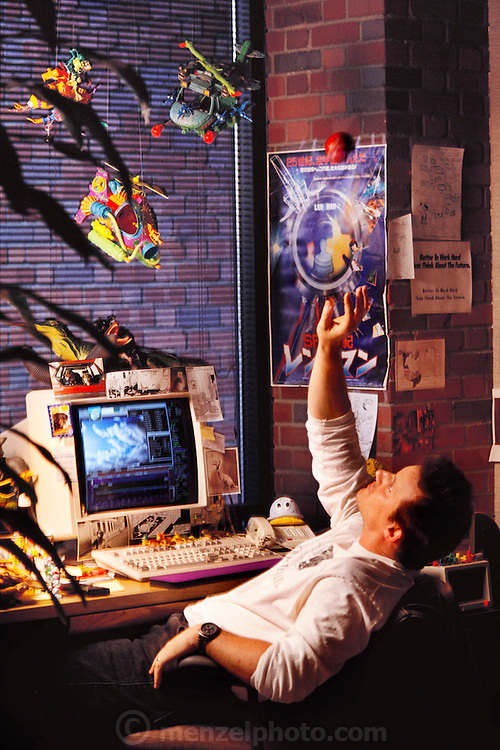"G. McQueen, senior animator, in his office of Pacific Data Images (PDI) in Sunnyvale, California.  1992. The company does computer animation and digital film effects: morphing. In 1996 PDI began collaborating with DreamWorks SKG, which then acquired PDI in 2004. .Creating believable 3D animated characters (War Games) and seamless transformations known as morphing (""Black and White"" and ""She's Mad""), PDI has been at the forefront of computer imagery. The studio pushed the boundaries of morphing in Michael Jackson's video ""Black or White"" with a sequence of twelve dynamic transformations of moving characters. In the innovative David Byrne video ""She's Mad,"" PDI pioneered the technology called performance animation, capturing the motion of David Byrne and infusing an animated character with his distinctive motion. ."