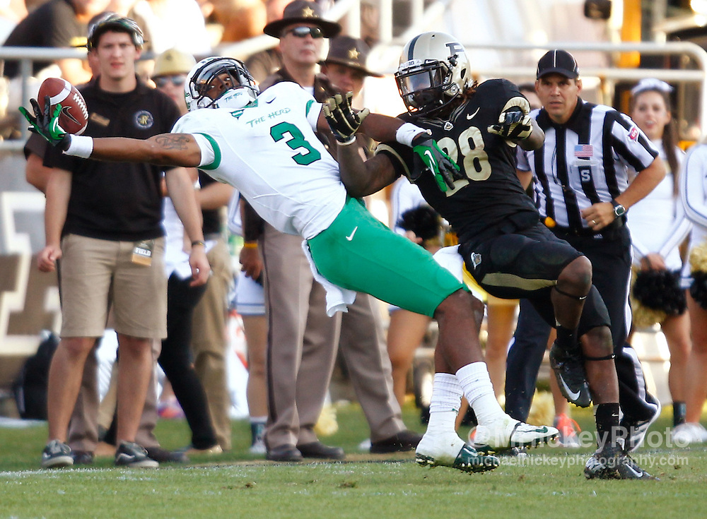 WEST LAFAYETTE, IN - SEPTEMBER 29: Aaron Dobson #3 of the Marshall Thundering Herd reaches back for a pass that fell incomplete as Josh Johnson #28 of the Purdue Boilermakers defends at Ross-Ade Stadium on September 29, 2012 in West Lafayette, Indiana. (Photo by Michael Hickey/Getty Images) *** Local Caption *** Aaron Dobson; Josh Johnson