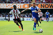 Brentford midfielder Romaine Sawyers (19)  chasing Ipswich defender and captain Luke Chambers (4), during the EFL Sky Bet Championship match between Brentford and Ipswich Town at Griffin Park, London, England on 13 August 2016. Photo by Matthew Redman.